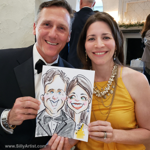 couple holding their caricature in a wedding in austin