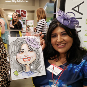 woman holding her trade show caricature in austin silly artist