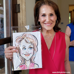 woman holding a caricature at a birthday party in Austin silly artist